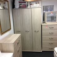 wooden wardrobes, and draws in a light oak