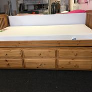 wooden bed with draws underneath